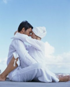 Couple in White Clothes Sitting Face to Face