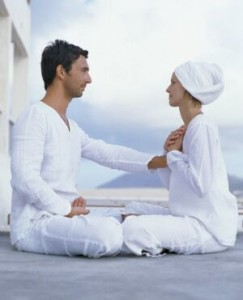Couple Sitting Face to Face Meditating --- Image by © Brigitte Sporrer/zefa/Corbis